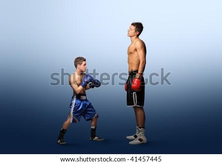 little boxer against bigger one - stock photo