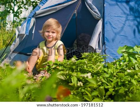 little boy about tent. summer outdoor sunlight - stock photo