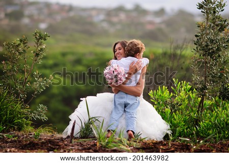 little boy and bride outdoor - stock photo