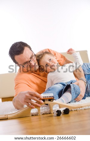 Little boy and father enjoying time together at home in living room. - stock photo