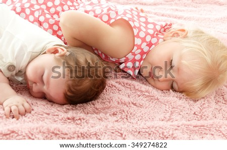 Little boy and girl asleep on a soft blanket. Closeup - Isolated on white background
