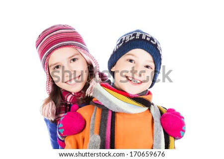 Little boy and girl hugging isolated on white - stock photo