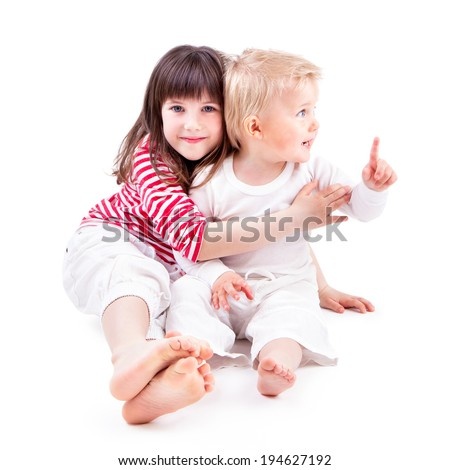 LITTLE BOY AND GIRL ON WHITE BACKGROUND - stock photo