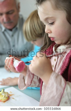 Little boy and  girl painting - stock photo