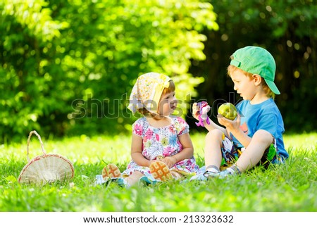 Little boy and girl playing on the grass