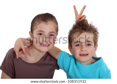 little boy and girl posing for a photo - stock photo