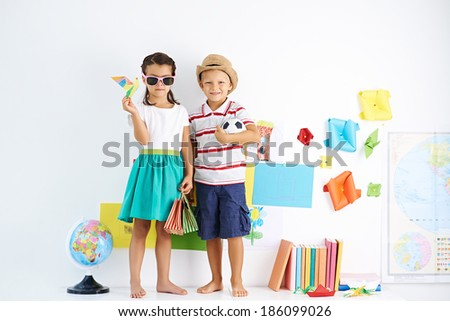 Little boy and girl ready for journey - stock photo