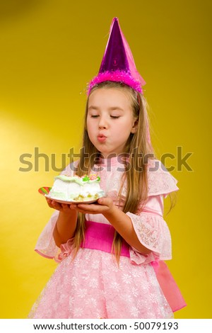 little boy and girl sit at a table on which stands the cake