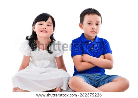little boy and girl sitting isolated on white - stock photo