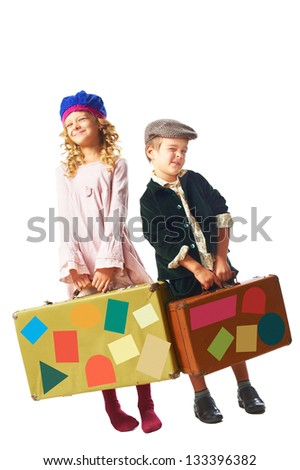 little boy and girl standing with suitcase in hand isolated on the white background - stock photo