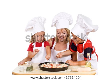 Little boy and girl with their mother preparing a pizza - isolated - stock photo