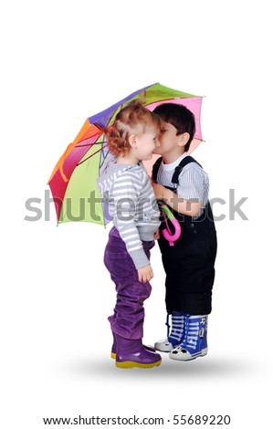 little boy and little girl together under the umbrella of color. On a white background. - stock photo