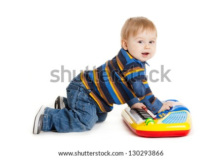 little boy and the keyboard on white background. funny boy baby. young DJ - stock photo