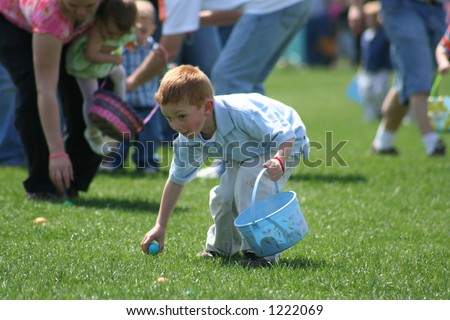 Little boy at Easter Egg Hunt - stock photo