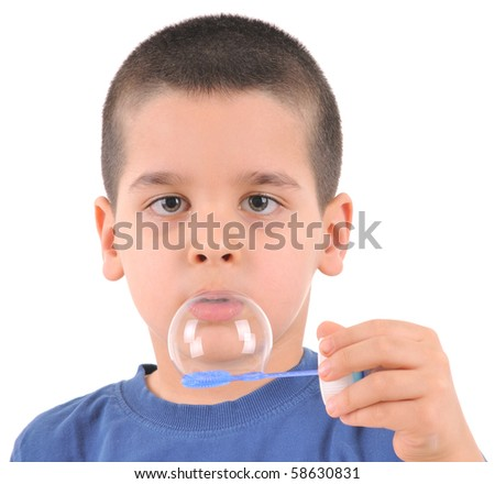 Little boy blowing soap bubbles - white background studio image.