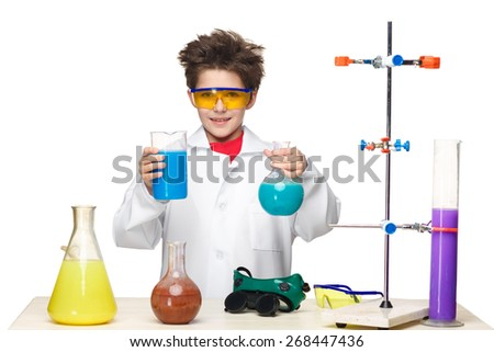 Little boy boy in a white coat as chemist doing experiment with multicolored chemical fluid in the laboratory isolated on white background - stock photo