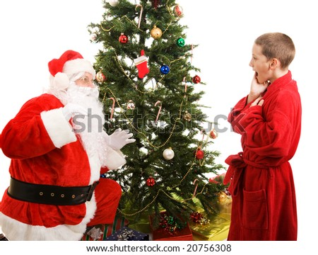 Little boy catches Santa in the act of bringing Christmas presents.  White background