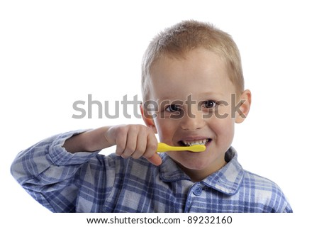 little boy cleaning his teeth. On white background