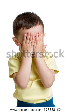 little boy closed eyes with his hands - stock photo