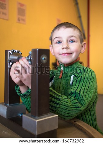 Little boy collects constructor - stock photo