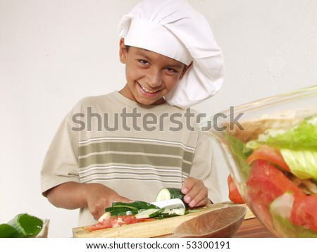 Little boy cooking. - stock photo