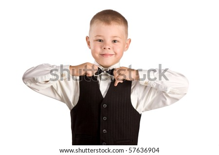 little boy corrects a tie - stock photo
