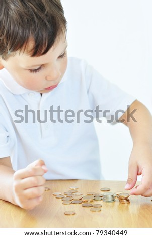Little boy counting his cash money - stock photo