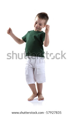 Little boy dancing, white background - stock photo