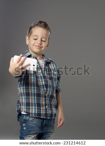 Little boy doing photo of her self over   - stock photo
