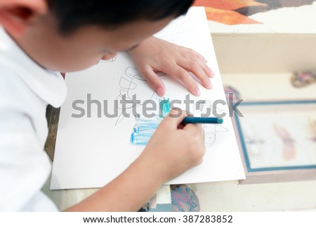 Little boy drawing dinosaur. - stock photo