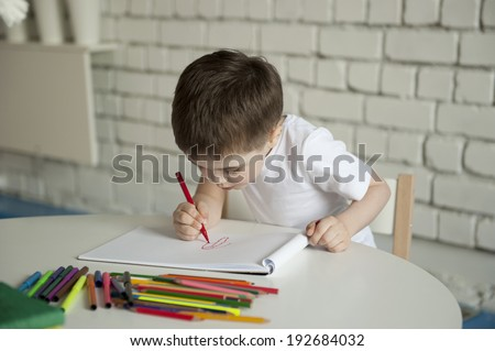 little boy draws - stock photo