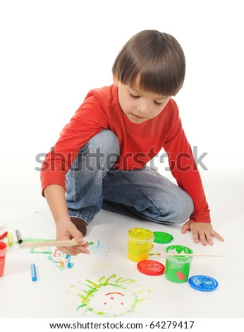 little boy draws paint. Isolated on white background - stock photo