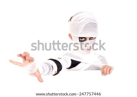 little boy dressed as a mummy on halloween isolated - stock photo
