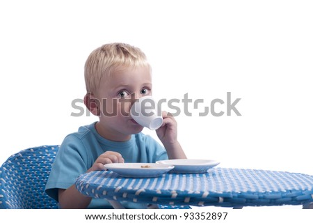 little boy drinking a cup op milk. isolated on white background - stock photo