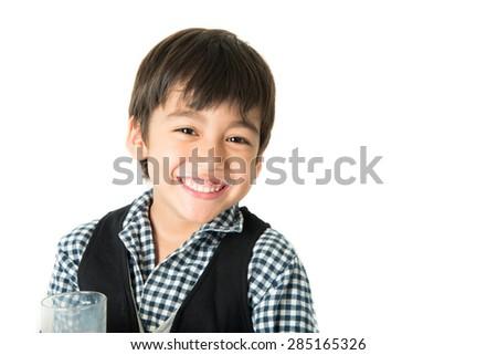 Little boy drinking milk on white background; - stock photo