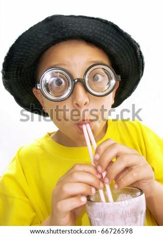 Little boy drinking milk shake. - stock photo