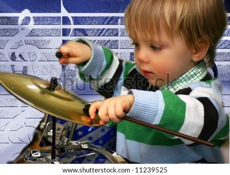 Little Boy Drumming, Music Background - stock photo