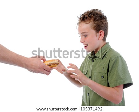 Little boy eating a hamburger. isolated on a white background - stock photo