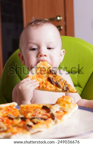 little boy eating a slice of pizza