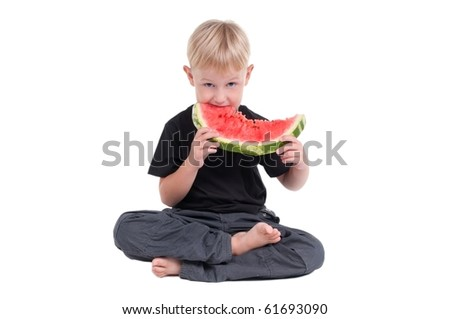 Little boy eating a slice of watermelon - stock photo