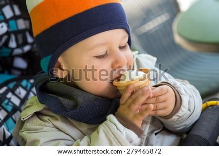 little boy eating an ice cream / Ice Cream - stock photo