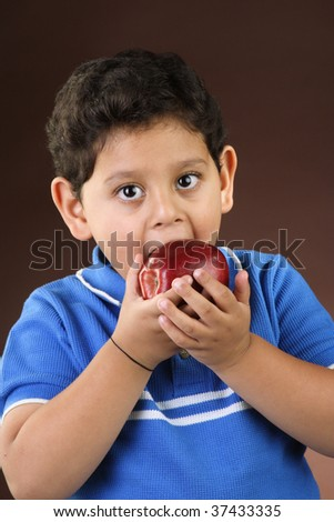 Little boy eating apple - stock photo