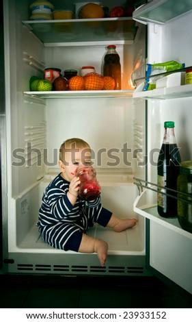 little boy eating jam in fridge - stock photo