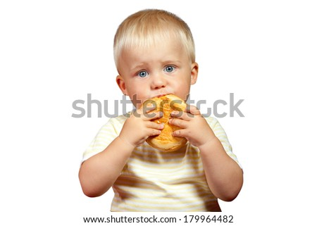 LITTLE BOY EATING ON A WHITE BACKGROUND - stock photo