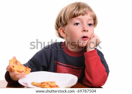 little boy eating pizza  - studio portrait - stock photo