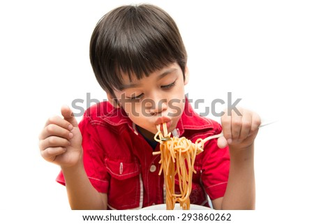 Little boy eating spaghetti - stock photo