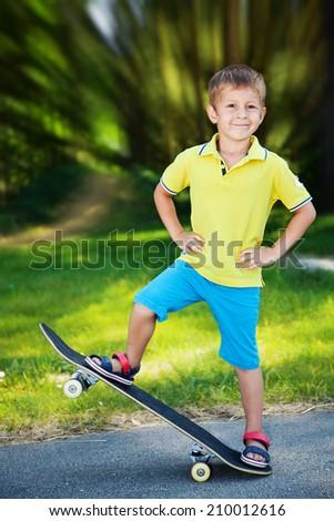 Little boy enjoying skateboarding in the park.  - stock photo