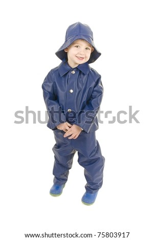 Little Boy fisherman is ready for rainy weather - stock photo