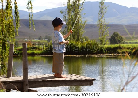 Boy fishing stock photos images pictures shutterstock for Little boy fishing