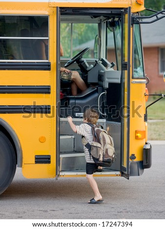 Little Boy Getting on Bus - stock photo